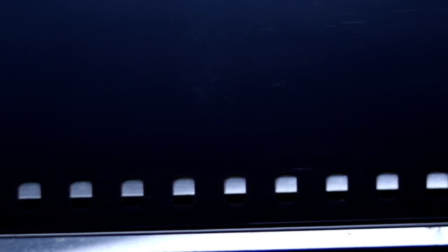 Loading 35mm film in to old vintage slr camera. Audio available