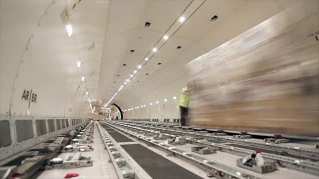 Loading cargo inside airplane cargo hold
