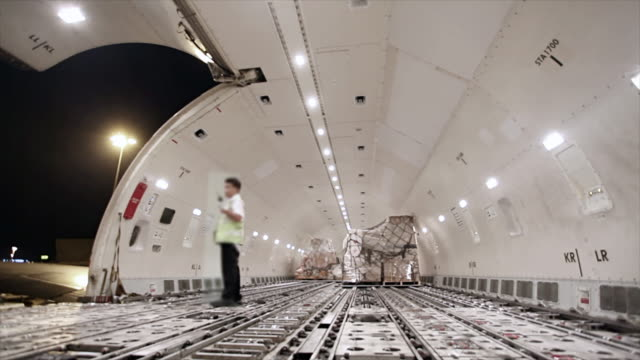 loading cargo inside airplane cargo hold - unloading stock videos & royalty-free footage