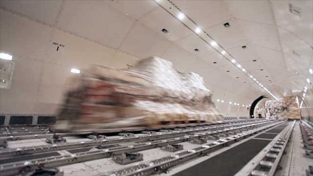 loading cargo inside airplane cargo hold - market retail space stock videos and b-roll footage