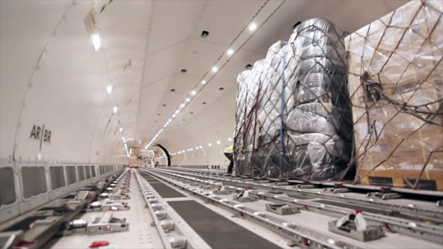 loading cargo inside airplane cargo hold - airfield stock videos and b-roll footage