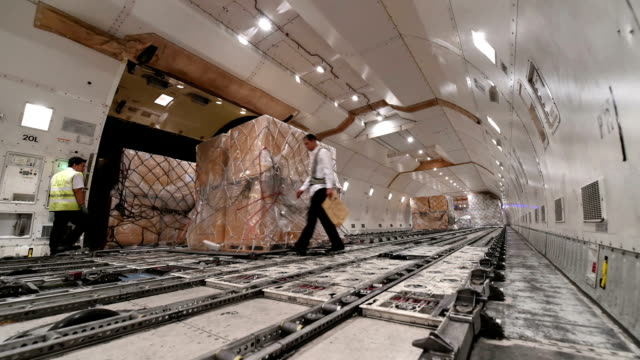 loading cargo inside cargo aircraft - shipping stock videos & royalty-free footage