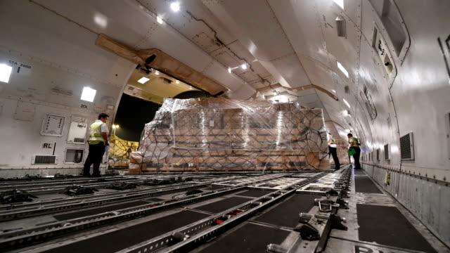 loading cargo inside cargo aircraft - cargo aeroplane stock videos & royalty-free footage