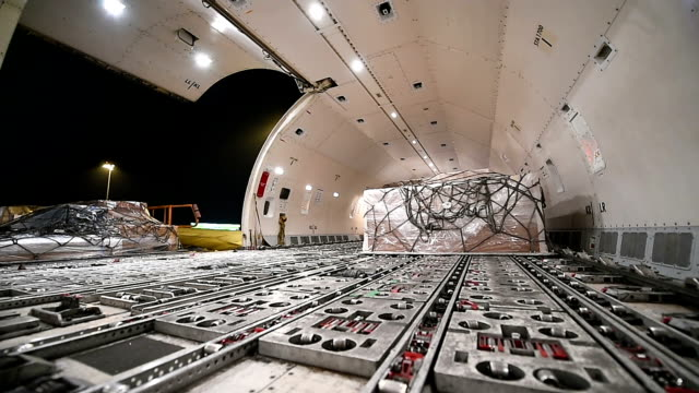 loading cargo inside cargo aircraft - loading stock videos & royalty-free footage