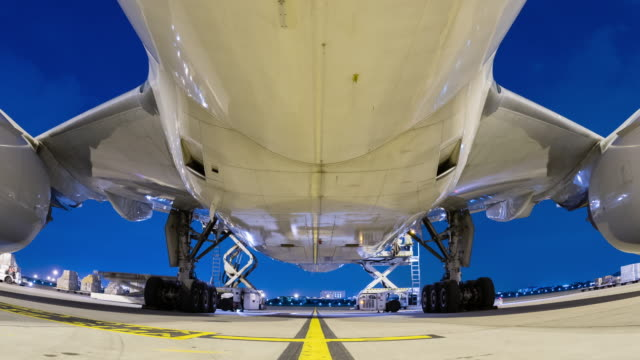 loading cargo outside cargo aircraft at twilight sky - cargo aeroplane stock videos & royalty-free footage