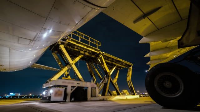 loading cargo outside cargo plane at night - time lapse - unloading stock videos & royalty-free footage