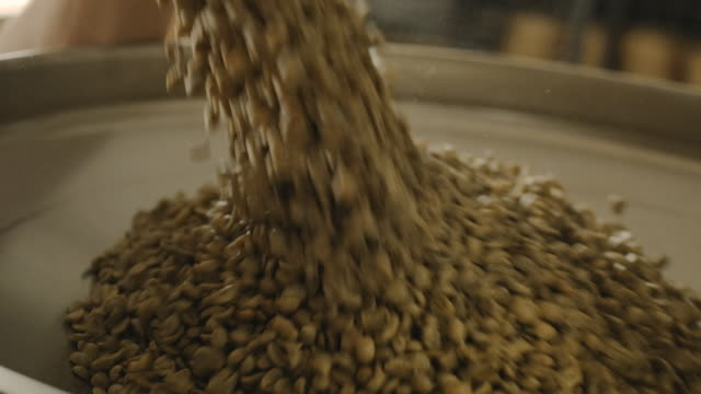 loading coffee in the coffee roaster 4k - raw food stock videos & royalty-free footage