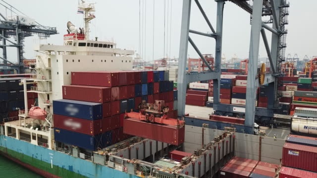 loading container into Container ship in the harbor