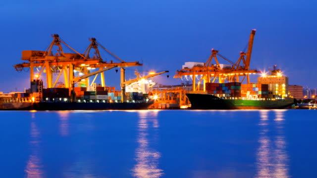 loading goods cargo in bangkok shipyard at dusk time lapse - unloading stock videos & royalty-free footage