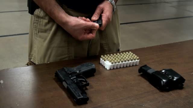 Loading handgun. Pistol and bullet.