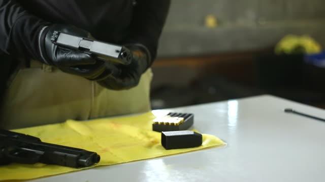 loading handgun. pistol and bullet. - handgun stock videos & royalty-free footage