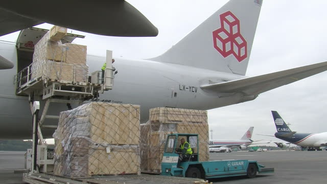 ms loading luggage in cargo airplane at cargo center / findel-airport, luxembourg, luxembourg-city, luxembourg - loading stock videos & royalty-free footage