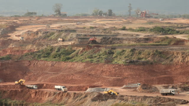 Loading of iron ore on very big dump body truck