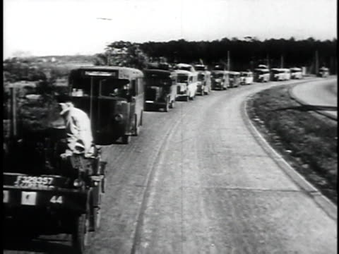 loading up bus, children waving / convoy / children in bus looking out / bus driving past sign british zone - orphan stock videos & royalty-free footage