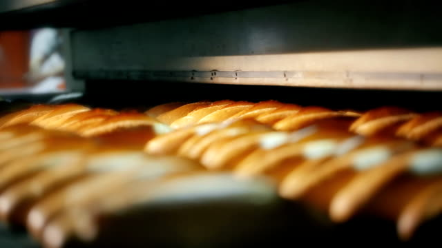 loaf of bread on the production line in the bakery - bread stock videos & royalty-free footage