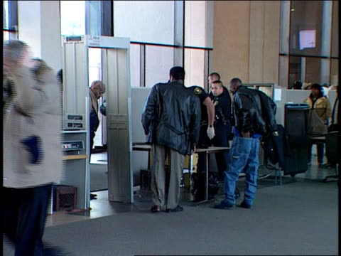 Lobby of the Cook County Sheriff People Going Through Security Scanner on December 05 2000 in Chicago Illinois