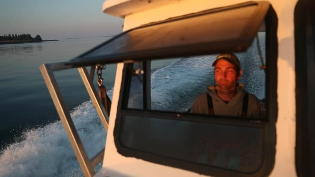 lobster fisherman nathaniel lane and his boat crew jeremy pratt and lance robbins motor out to check on traps in the gulf of maine on july 03, 2019... - lobster stock videos & royalty-free footage