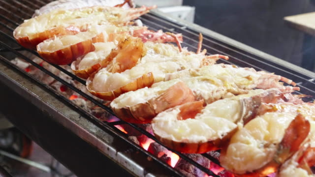 lobster grill on net in yaowarat road china town in bangkok,thailand - lobster stock videos & royalty-free footage