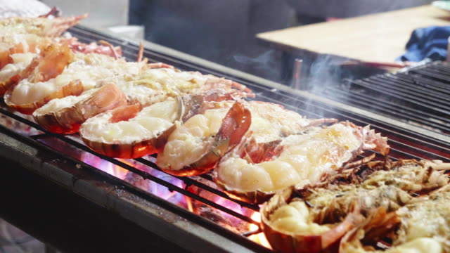 lobster grill on net in yaowarat road china town in bangkok,thailand - seashell stock videos & royalty-free footage