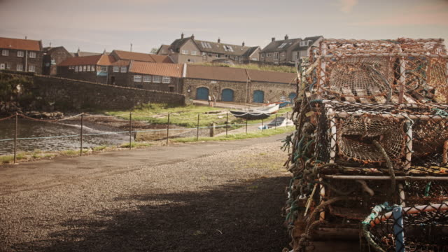 lobster pots in craster harbour - northumberland coast stock videos & royalty-free footage