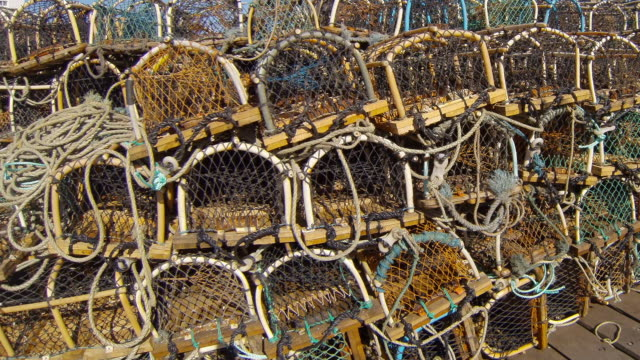 lobster pots on the quayside at whitby - whitby north yorkshire england stock videos & royalty-free footage