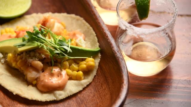 vídeos de stock e filmes b-roll de lobster taco and a shot of tequila - modo de preparação de comida