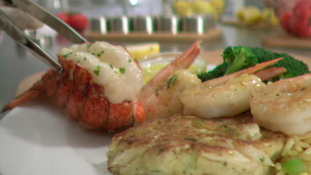 ms pov slo mo lobster tail being plate / los angeles, ca, united states - lobster seafood stock videos and b-roll footage