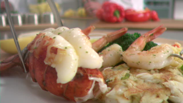 ms pov slo mo lobster tail being plate / los angeles, ca, united states - seafood stock videos & royalty-free footage