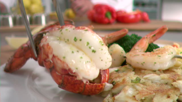 stockvideo's en b-roll-footage met ms pov slo mo lobster tail being plate / los angeles, ca, united states - staartjes