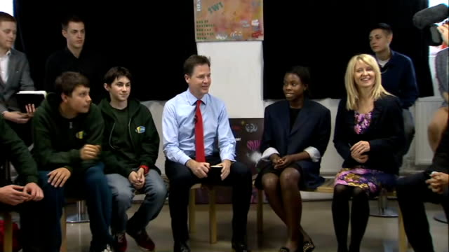 local and european elections aftermath / nick clegg under pressure; st andrew's youth club: clegg sat with youth club members and others - youth club stock videos & royalty-free footage