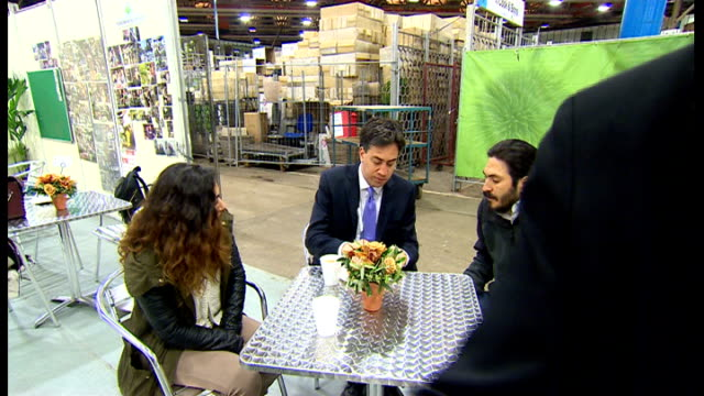 campaigning continues england london photography*** ed miliband mp shaking hands with market staff at indoor market who have made him a bacon... - bacon stock videos & royalty-free footage