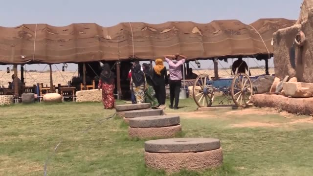 stockvideo's en b-roll-footage met local and foreign tourists visit archaeological site of harran which is on the unesco world heritage temporary list in southeastern province of... - human interest