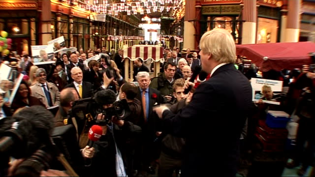 candidates canvassing graphicised shot back view of boris johnson surrounded by supporters chanting his name sot freeze frame group of johnson... - poster frame stock videos & royalty-free footage