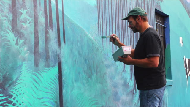 MS Local artist working on outdoor mural / Portland, Oregon, USA