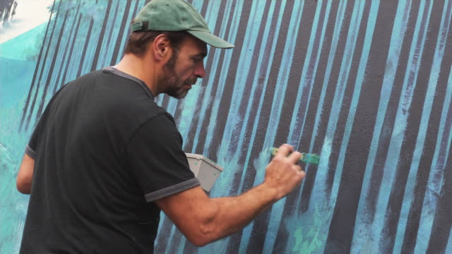 ms local artist working on outdoor mural / portland, oregon, usa - painting stock videos & royalty-free footage