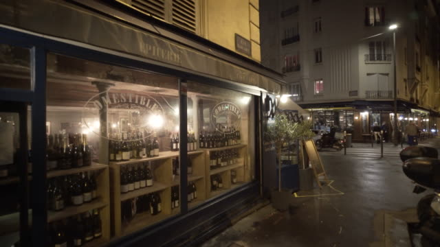local bars in montmartre, paris on a winter city break at night. - wine bar stock videos & royalty-free footage