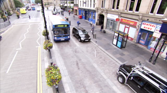 a local bus passes traffic on a shopping street in newcastle. available in hd. - newcastle upon tyne stock videos & royalty-free footage