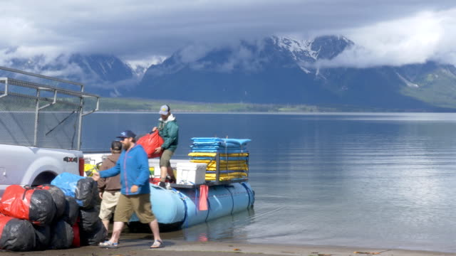 local business provides kayak service to tourists at grand teton national park. - grand teton stock videos & royalty-free footage