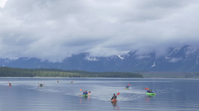local business provides kayak service to tourists at grand teton national park. - grand teton stock-videos und b-roll-filmmaterial