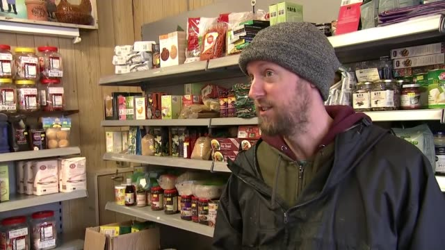 local businesses in pontypridd counting cost of global climate crisis pontypridd uk reporter along into shop with caspar harris and interview various... - flooring stock videos & royalty-free footage