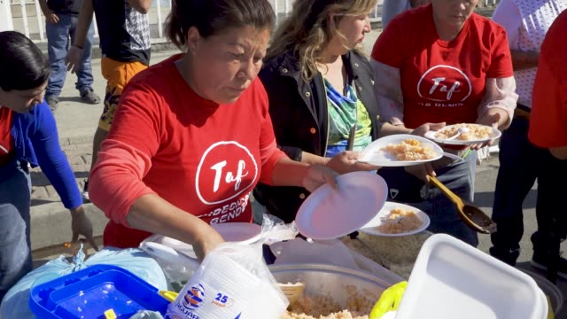 a local christian church 'the taf church of tijuana' distributed food and prayed with members of the central american migrant caravan that are... - baja california norte stock videos & royalty-free footage