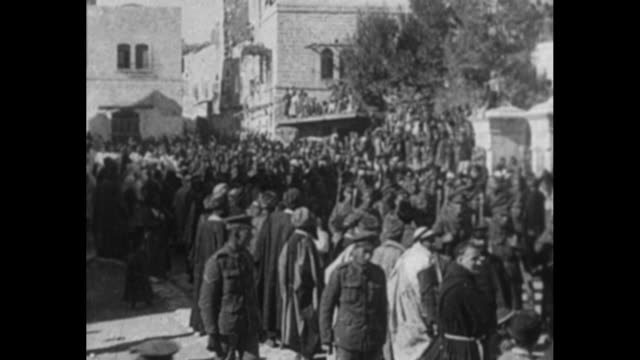 VS local citizens line streets as British soldiers march through Bethlehem / VS soldiers use sandbags to erect an observation post / Note exact...