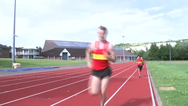 local community crowdfunds 5000 pounds to send volunteer athletics coach to rio 2016 england sussex lewes lewes athletics club ext various of... - 記号点の映像素材/bロール