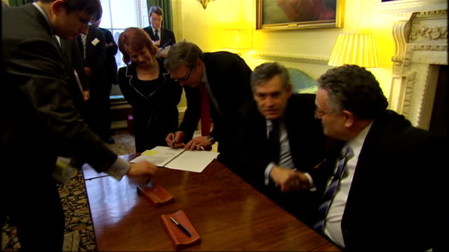 local councils given greater spending power downing street reception / speeches brown and local council representatives taking part in signing... - downing street stock-videos und b-roll-filmmaterial