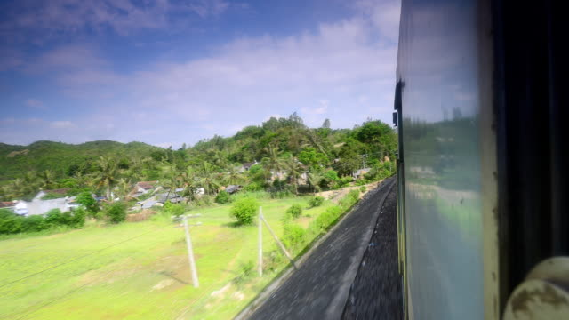 ms t/l pov local countryside views from reunification express train / ho chi minh city, vietnam - vietnam meridionale video stock e b–roll