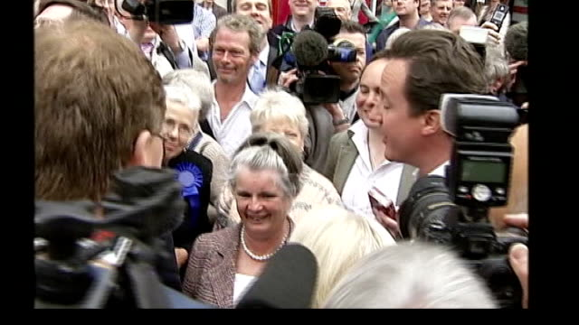 conservatives england chester ext man in crowd surrounding conservative leader david cameron in street takes his photograph with digital camera david... - digital camera stock videos & royalty-free footage