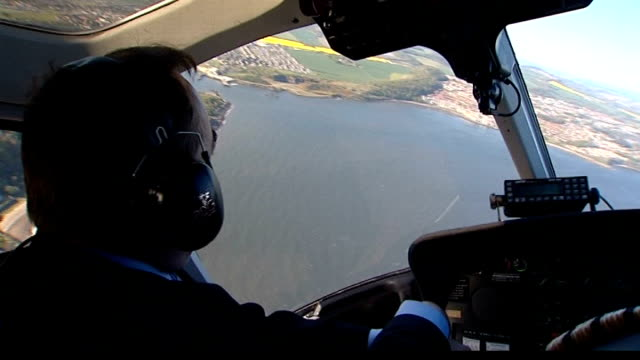 alex salmond salmond in helicopter as north queensferry and south queensferry shorelines estuary and bridges seen out of window track - alex salmond stock videos & royalty-free footage