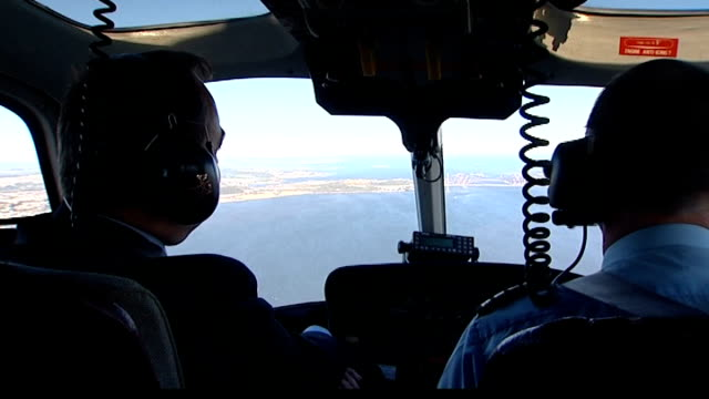 alex salmond scotland firth of forth alex salmond looking out over estuary as forth bridge seen in background track and chatting to helicopter pilot - helicopter pilot stock videos & royalty-free footage