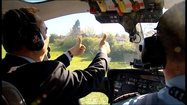 campaigning across uk int back view alex salmond in helicopter as coming down to land and making thums up signs snp helicopter hovering above ground - alex salmond stock videos & royalty-free footage