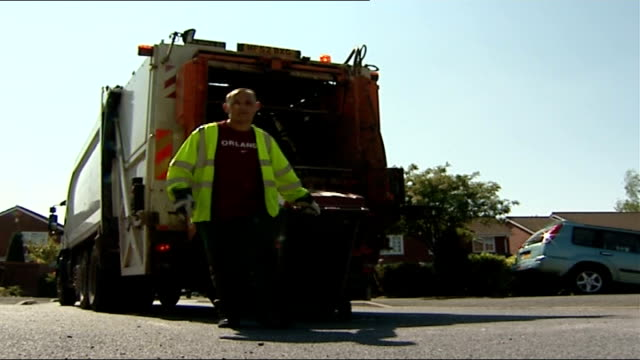 campaigning across uk refuse collector towards dragging rubbish bin - dragging stock videos & royalty-free footage